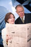 Business partners reading financial paper Stock Photography