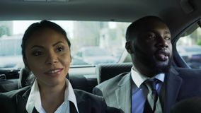 Business partners riding on back seat of car, secret office romance relationship. Stock footage stock video