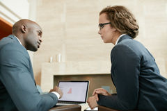 Business partners in serious discussions at restaurant Royalty Free Stock Image