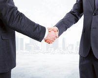 Business partners shake hands at city background Royalty Free Stock Photo