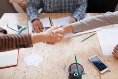 Business partners shake hands in the conference room. royalty free stock image