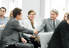 Business partners shake hands in the conference room Royalty Free Stock Photo