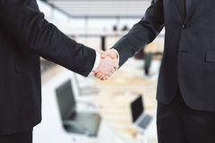 Business partners shake hands in the office Royalty Free Stock Photos