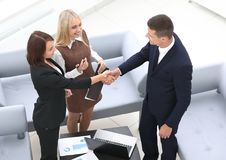 Business partners shake hands before the talks Stock Images