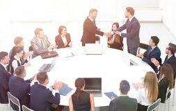 Business partners shake hands at the talks near the round table. The concept of partnership Royalty Free Stock Photography