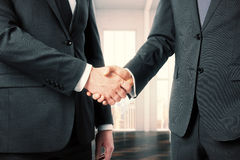 Business partners shake their hands in office Royalty Free Stock Photo