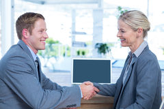 Business partners shaking hand together Stock Images