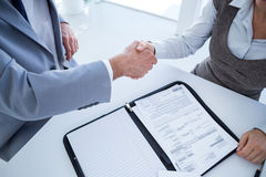 Business partners shaking hand together Stock Photos