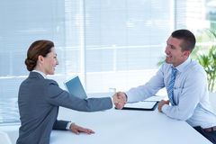Business partners shaking hand together. In an office Stock Image