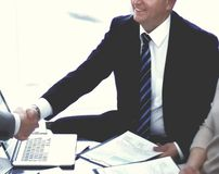 Business partners shaking hands during business meeting royalty free stock photo