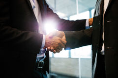 Business partners shaking hands with each other Stock Images