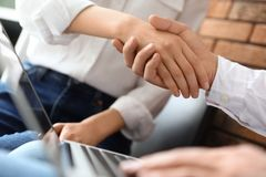 Business partners shaking hands after meeting. Closeup stock photography