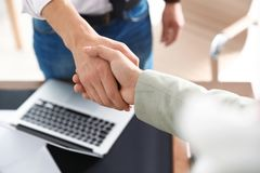 Business partners shaking hands after meeting. Closeup stock image