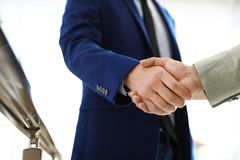 Business partners shaking hands after meeting. Closeup stock images
