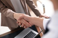 Business partners shaking hands after meeting. Closeup stock photo