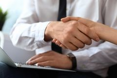 Business partners shaking hands after meeting. Closeup royalty free stock image