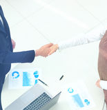 Business partners shaking hands in meeting hall Royalty Free Stock Image