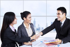 Business partners shaking hands at meeting Stock Images
