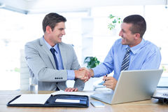 Business partners shaking hands Stock Photos