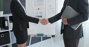 Business partners shaking hands at office. Meeting stock video