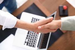 Business partners shaking hands over table after meeting. Top view royalty free stock images