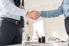 Business Partners Shaking Hands over Table stock images