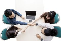 Business partners shaking hands on studio Royalty Free Stock Images