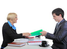 Business partners share the documents. Stock Photo