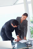 Business partners signing contract Stock Images