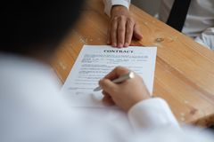 Business partners signing a contract royalty free stock photos
