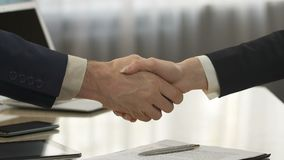 Business partners signing contract and shaking hands, deal, strategic decision. Stock footage stock footage