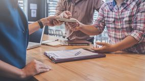 Business partners signing contract to borrow money from investor. To invest at own business royalty free stock photo