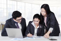 Business partners signing a document Stock Photos