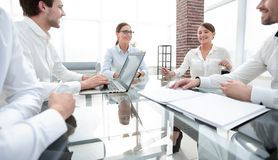 Business partners sitting at the Desk.meetings and partnerships. Business partners sitting at the negotiating table.meetings and partnerships royalty free stock image