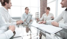 Business partners sitting at the Desk.meetings and partnerships. Business partners sitting at the negotiating table.meetings and partnerships stock images