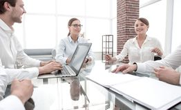 Business partners sitting at the Desk.meetings and partnerships. Business partners sitting at the negotiating table.meetings and partnerships royalty free stock photography
