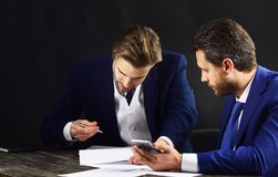 Business partners with smartphone, documents and contract. Stock Image