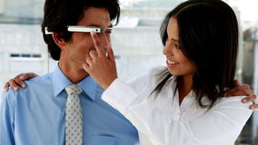 Business partners smiling at camera together with smart glasses stock video footage
