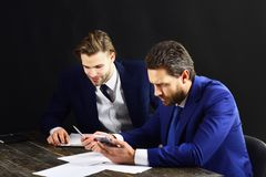 Business partners with smiling and serious faces. Stock Image