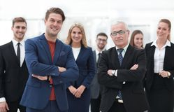 Business partners standing in front of the business team. The concept of partnership Royalty Free Stock Images