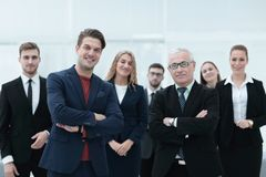 Business partners standing in front of the business team. The concept of partnership Royalty Free Stock Photo