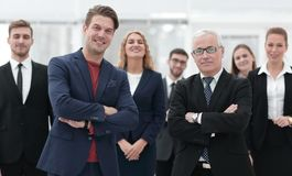 Business partners standing in front of the business team. The concept of partnership Stock Images