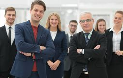 Business partners standing in front of the business team. The concept of partnership Royalty Free Stock Photos
