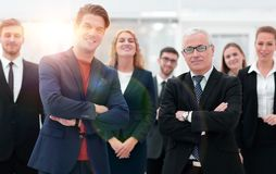 Business partners standing in front of the business team. The concept of partnership Stock Photos
