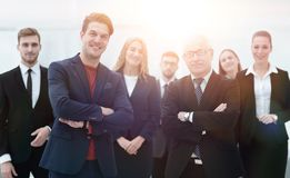 Business partners standing in front of the business team. The concept of partnership Stock Photo