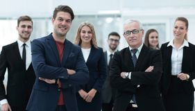 Business partners standing in front of the business team. The concept of partnership Stock Photography
