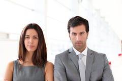 Business partners standing in hallway Stock Photo