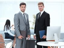 Business partners standing in a modern office. Photo with copy space Royalty Free Stock Photography