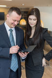 Business partners standing in room with notepad royalty free stock photos