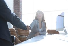 Business partners stretching out their hands for a handshake Royalty Free Stock Images